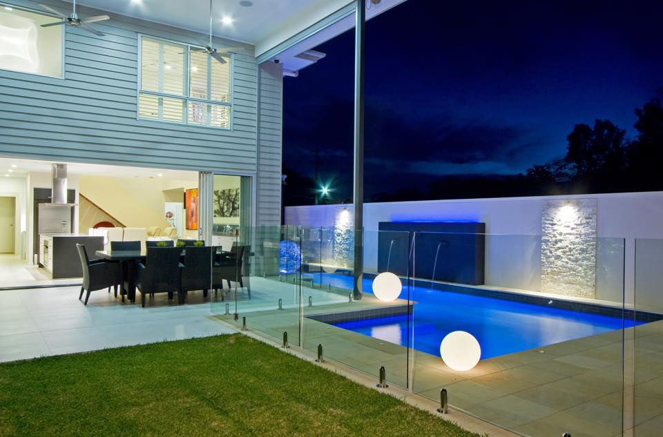 Modern lap pool design with custom sphere shaped lighting surrounding the swimming pool.